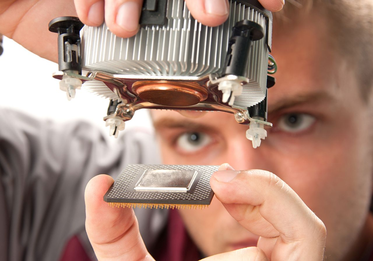 A student is holding a processor with cooling